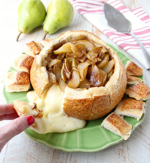 Hand pulled bread from baked brie bread bowl with caramelized pears