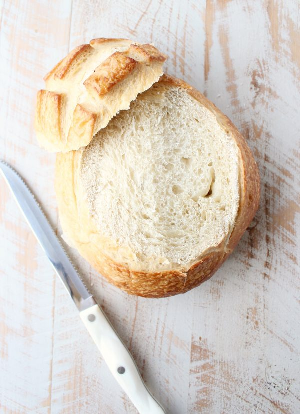 round sourdough bread with serrated knife