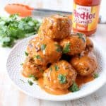 These Honey Mustard Buffalo Meatballs are sweet, hot & tangy! They're perfect as a game day or party appetizer, or served on rolls as meatball subs!