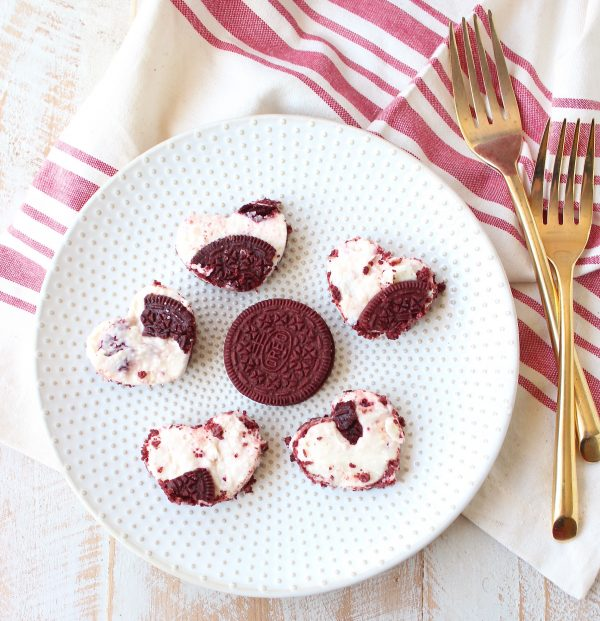 These delicious no bake cheesecake bars with a Red Velvet Oreo crust are sweet, decadent and can be cut into heart shapes for a cute Valentine's Day Treat!