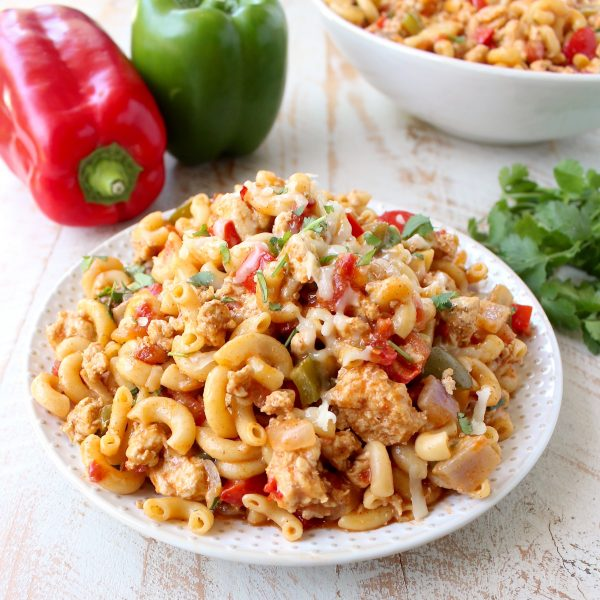 In one pot and only 29 minutes, prepare a delicious chicken fajita pasta dish that will easily become a weeknight family favorite!