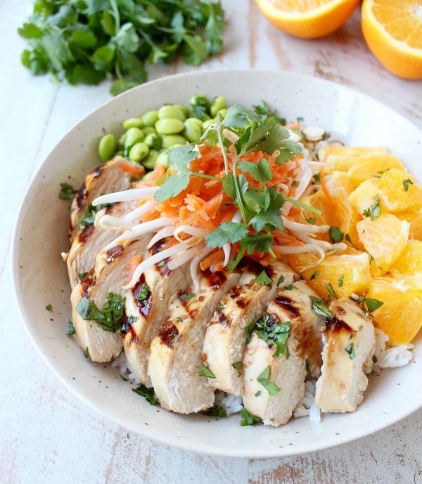 Sesame ginger marinated & grilled chicken tops these Healthy Asian Chicken Rice Bowls filled with oranges, almonds, veggies & tons of flavor!