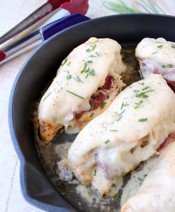 Reuben chicken is tossed with thousand island dressing, stuffed with sauerkraut & corned beef & topped with swiss cheese for a tasty, easy dinner recipe!