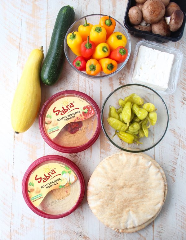 Mediterranean grilled vegetables, pita bread & feta cheese are served with an assortment of flavored hummus on this delicious veggie & hummus plate!