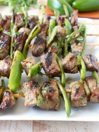 These Steak Kabobs are marinated in a delicious honey lime jalapeno marinade then skewered with fresh jalapenos & tossed on the grill for a delicious meal!