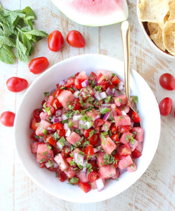Watermelon salsa is refreshing, flavorful and will be the hit of the summer! Serve it with tortilla chips for a vegan and gluten free snack or serve it over chicken, fish or tacos for a delicious meal!