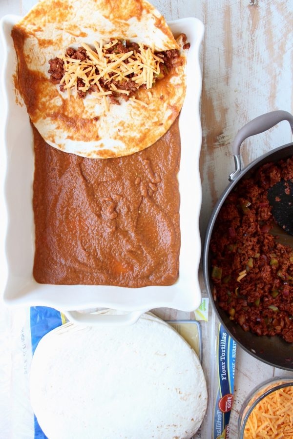 Pumpkin enchiladas put a great fall spin on the traditional Mexican dish, made with a simple red pumpkin sauce & filled with chorizo, cheese or veggies!