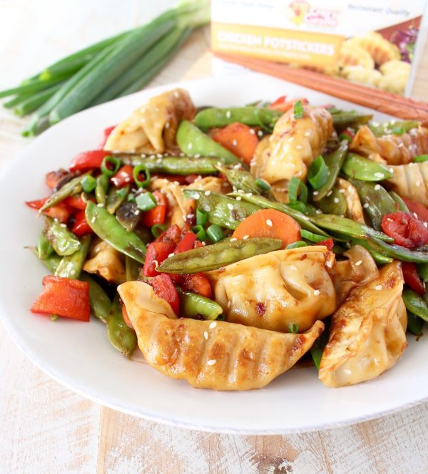 In this scrumptious Chicken Potsticker Stir Fry recipe, fresh veggies, chicken potstickers and a simple stir fry sauce are tossed together in one pan in under 30 minutes for an easy weeknight meal!