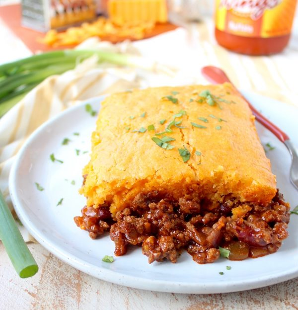 Traditional cornbread chili pie is kicked up a notch in this downright delicious version made with buffalo sauce and cheddar cheese!