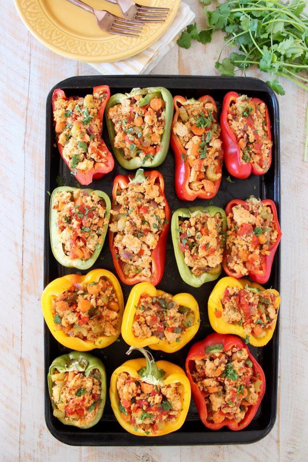 Buffalo chicken stuffed bell peppers on baking sheet
