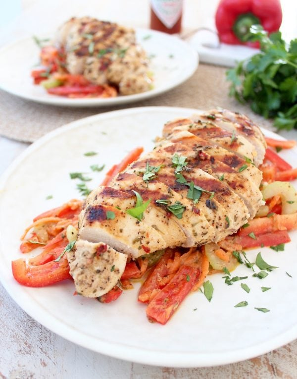 This recipe features the best cajun chicken marinade ever, that just so happens to also be dairy free, gluten free and Whole30! Grill the chicken up and serve it with Bell Pepper Cajun Slaw for a healthy, complete meal.