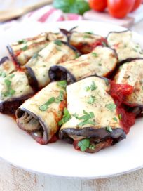 Italian seasoned ground turkey and mushrooms fill these delicious eggplant roll ups, baked in a flavorful tomato sauce. This recipe is gluten free, dairy free and Whole30 compliant!