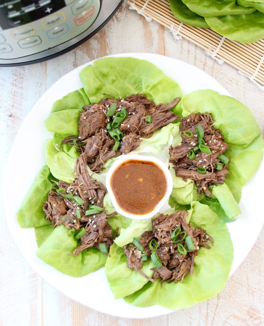 Whole30 Thai Beef is easy to make in the Instant Pot in under an hour. Shred the beef and serve it in lettuce wraps for a Whole30 meal or serve it in corn tortillas for a gluten free Thai twist on Taco Tuesday!