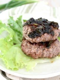 Whole30 Hamburgers are healthy, packed with protein, and gluten free, they're wrapped in lettuce and topped with a sesame scallion sauce for a flavorful meal!