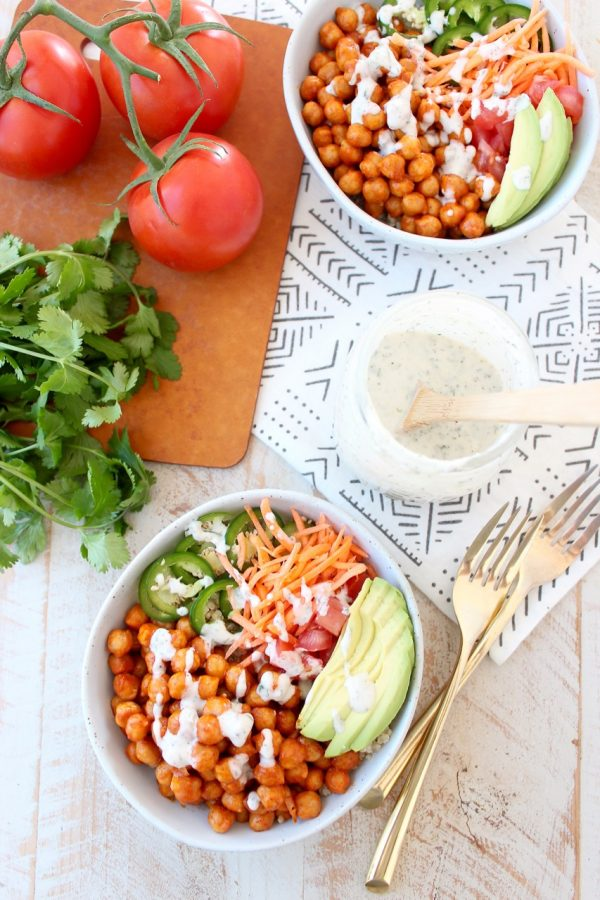 Buffalo chickpeas, quinoa and veggies are tossed together in this healthy, gluten free, vegan buddha bowl recipe, topped with an easy homemade vegan ranch dressing, all made in just 20 minutes!