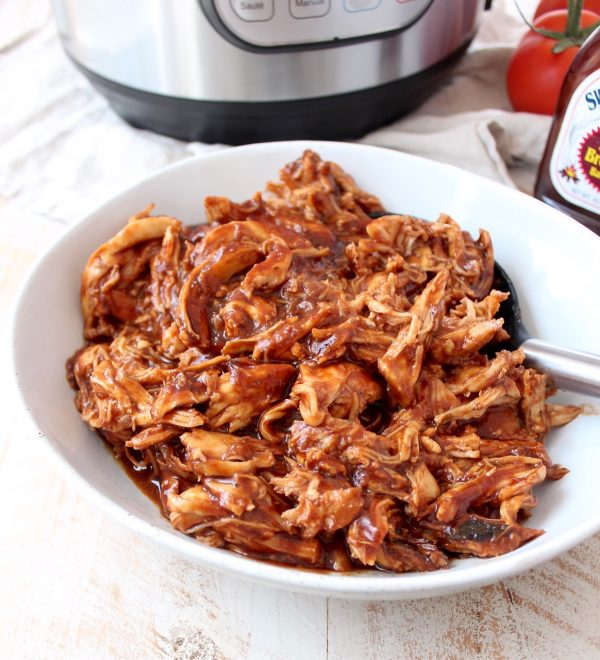 Instant Pot BBQ Chicken is easy to make with chicken breasts, directly from the freezer or refrigerator, plus a bottle of your favorite BBQ sauce. Use it to make different recipes throughout the week, from pasta for dinner, to wraps for lunch!