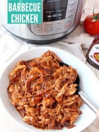 overhead image of shredded bbq chicken in a bowl with a serving spoon