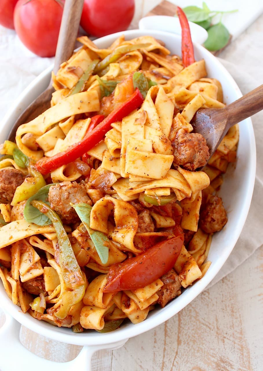 Italian Drunken Noodles in serving dish with serving spoons