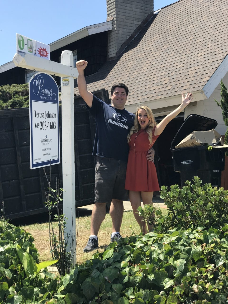Homeowners Celebrating in front of house