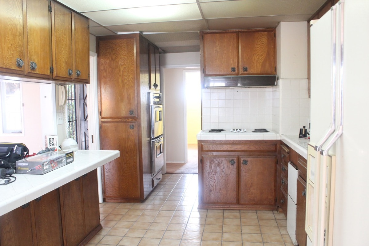 Old kitchen layout with brown cabinets