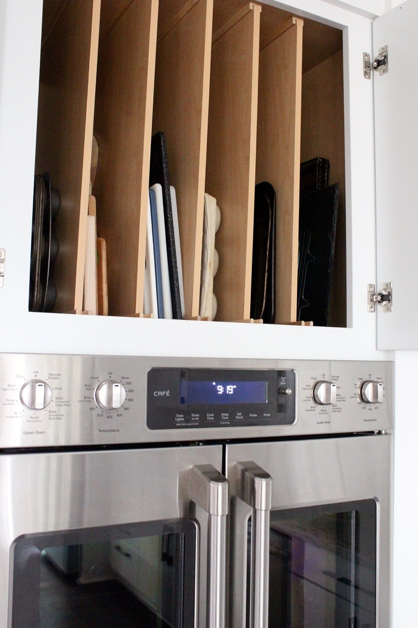 Above oven cutting board and baking sheet organizer