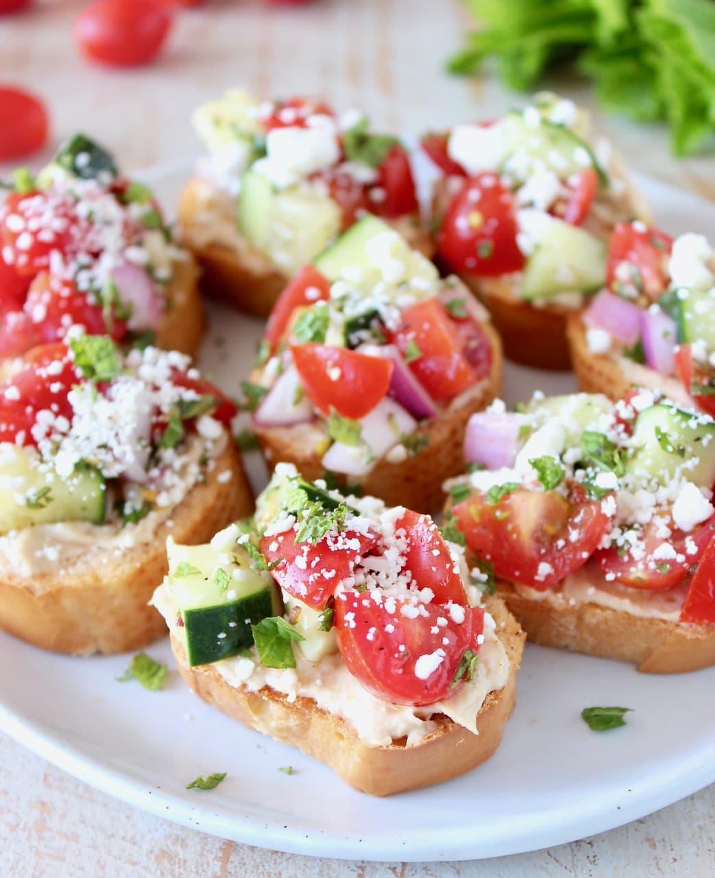 Greek Bruschetta - Tomato Cucumber, Hummus and Feta Cheese on Toasted Baguettes