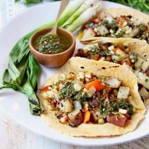 Vegan Tacos filled with Grilled Potatoes, Peppers Corn and Chimichurri Sauce