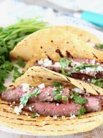 Sliced Cajun Marinated Grilled Skirt Steak in Grilled Corn Tortillas with Cotija Cheese and Fresh Cilantro