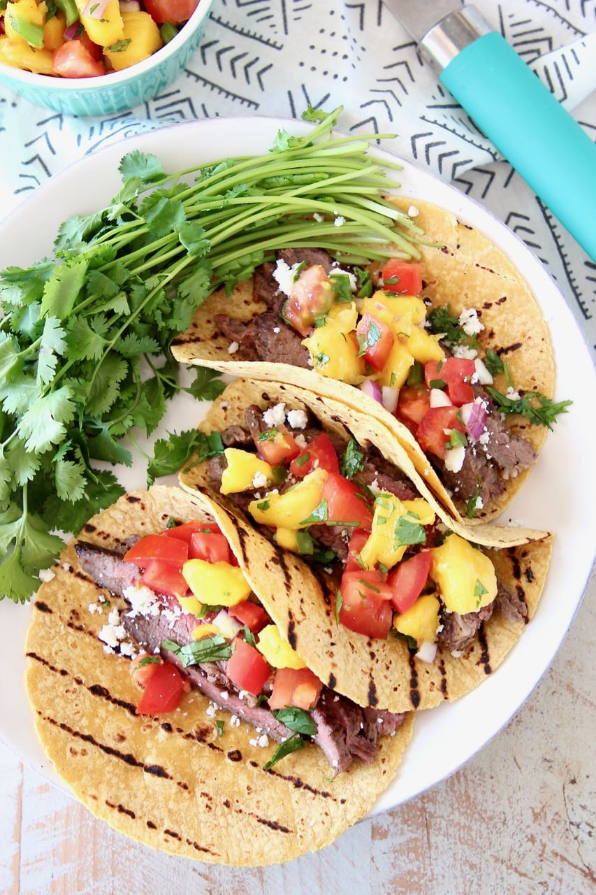 Cajun Steak Tacos on Grilled Corn Tortillas with Fresh Mango Salsa and Cilantro