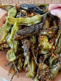 cooked shishito peppers in wooden bowl