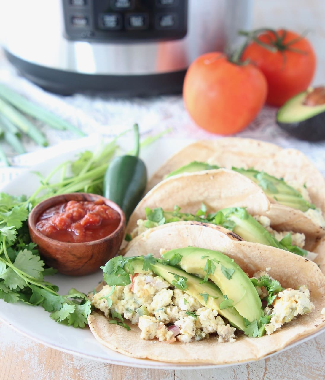 Pressure Cooker Breakfast Tacos with eggs, avocado, cilantro and salsa