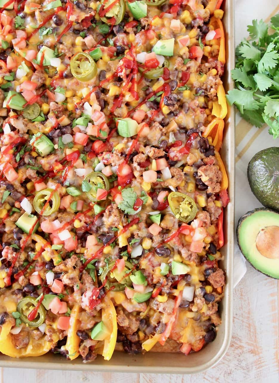 nachos made with sweet mini peppers, covered in taco seasoned ground turkey, corn, tomatoes, black beans, cheese and jalapenos