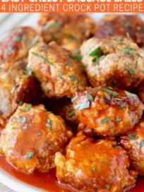 sausage balls stacked up on plate covered with buffalo sauce