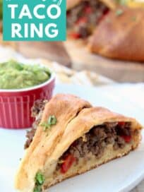 Crescent roll wrapped ground beef taco ring slice on plate