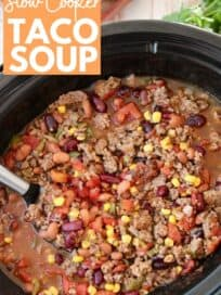 overhead image of taco soup in slow cooker with serving spoon