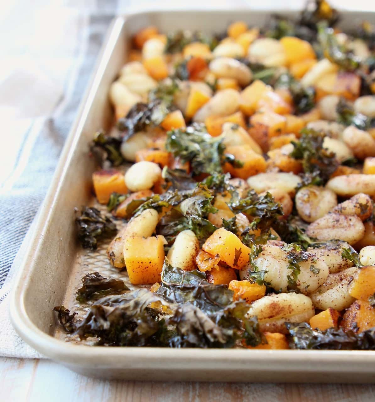 Baked gnocchi, butternut squash and kale on sheet pan