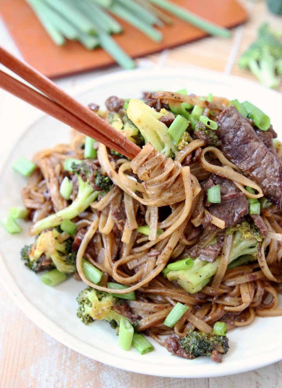 Black Pepper Beef and Broccoli with Noodles, swirled by chopsticks