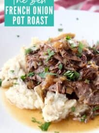 shredded pot roast with mashed potatoes on plate