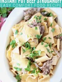 Overhead image of beef stroganoff with thick egg noodles in a white serving bowl