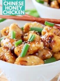 honey chicken in bowl with chopsticks
