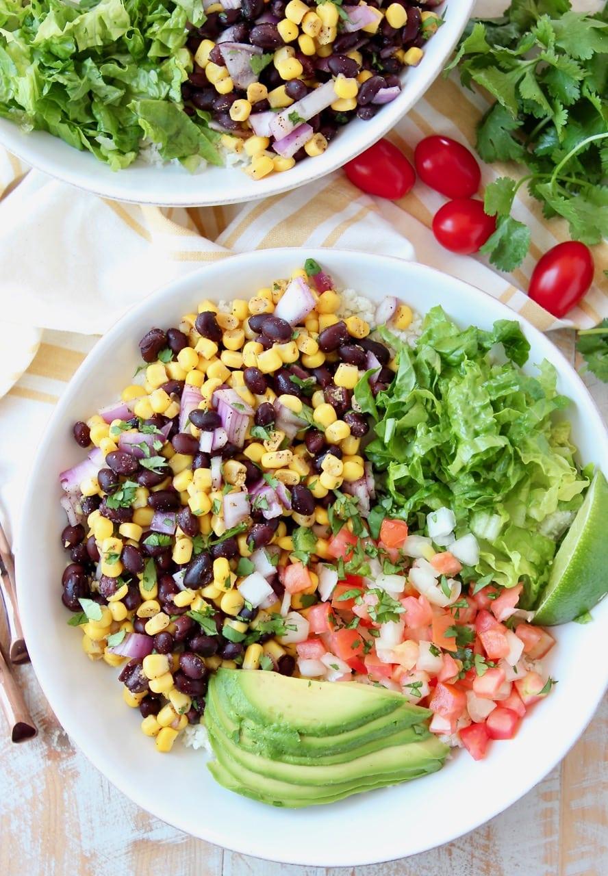 Burrito bowl filled with corn and black bean relish, pico de gallo, avocado and shredded lettuce