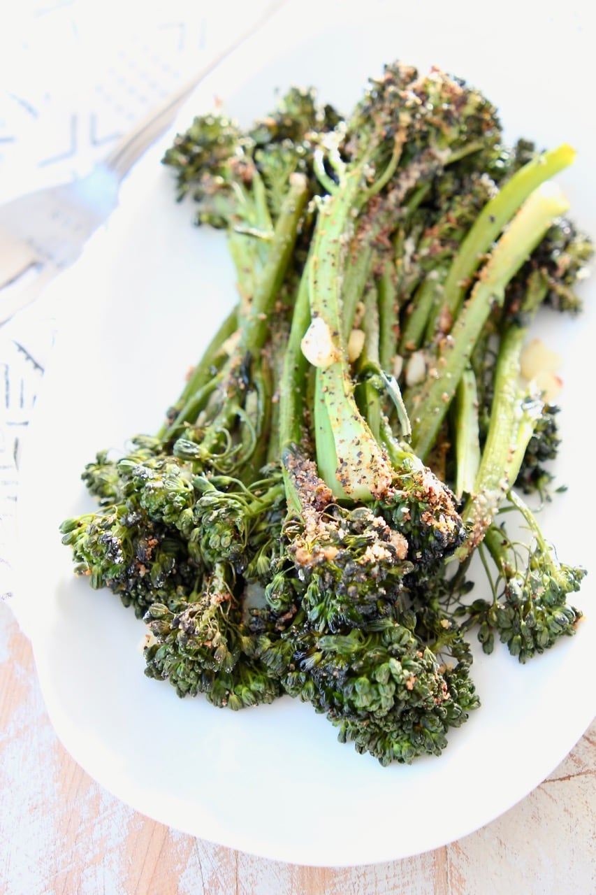 Roasted broccolini on white plate