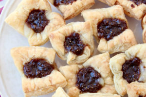 Puff pastry cups filled with brie and fig butter