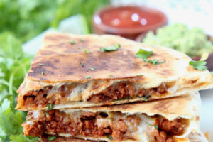 Slices of soyrizo quesadilla stacked up on plate