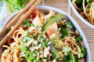 Thai peanut noodles in bowl with vegetables