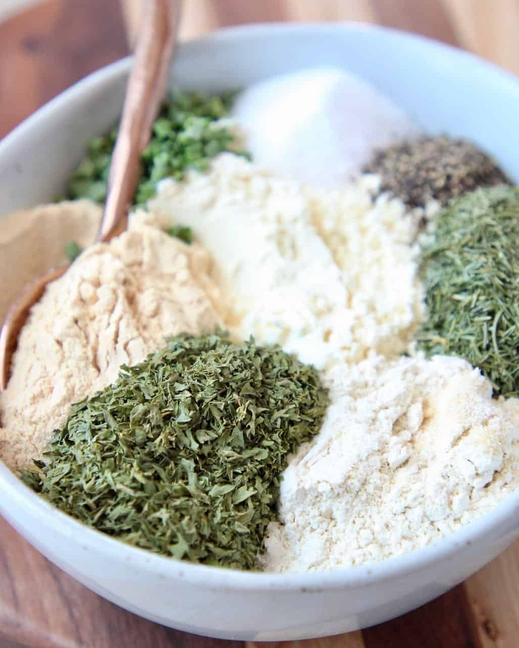 Homemade ranch seasoning mix ingredients separated in a bowl
