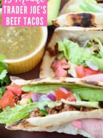 Ground beef taco with shredded lettuce and diced tomatoes