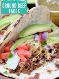 Ground beef taco with sliced avocado and diced tomatoes