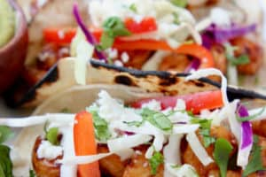 Grilled shrimp tacos with slaw on plate