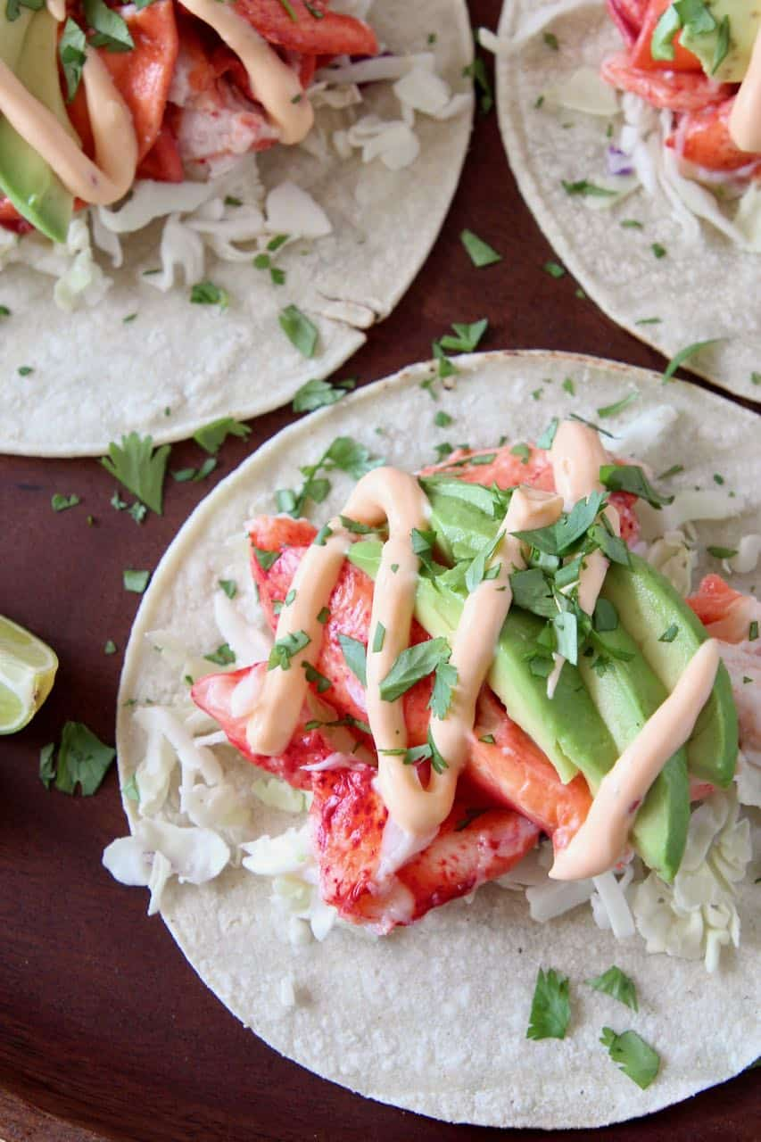 Lobster tacos on wood serving tray